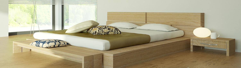 Bett mit Nachtkästchen im Schlafzimmer